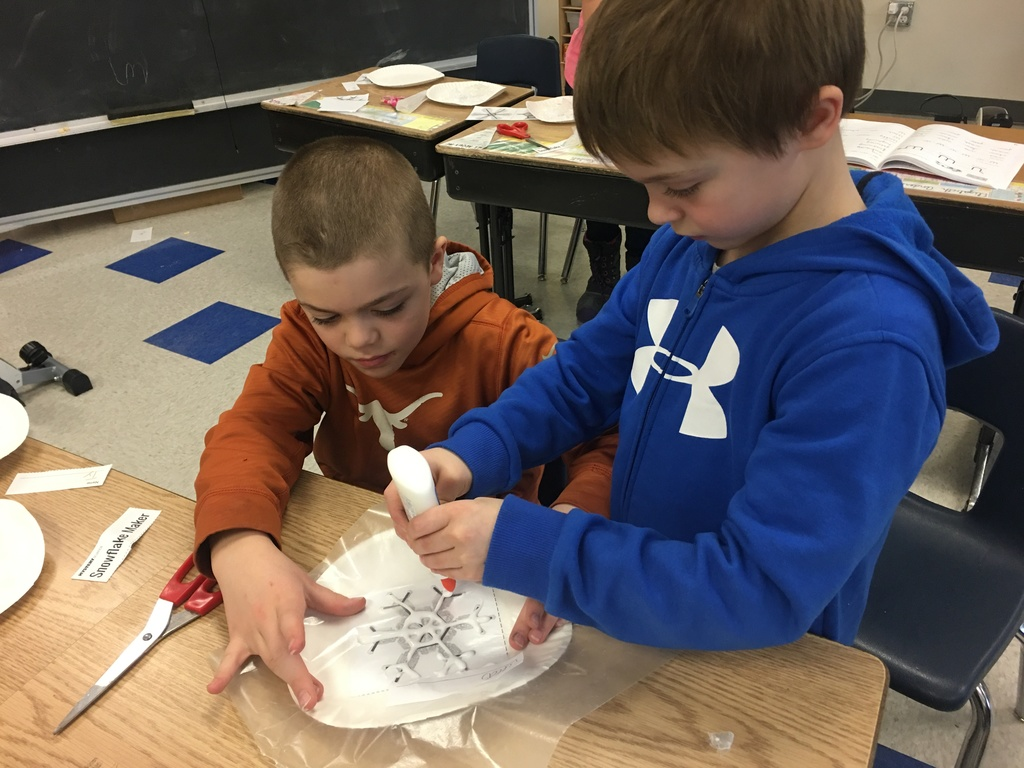 "Students in Mrs. Viren's class are working on a science activity to explore the question, ""Why is snow white?"""